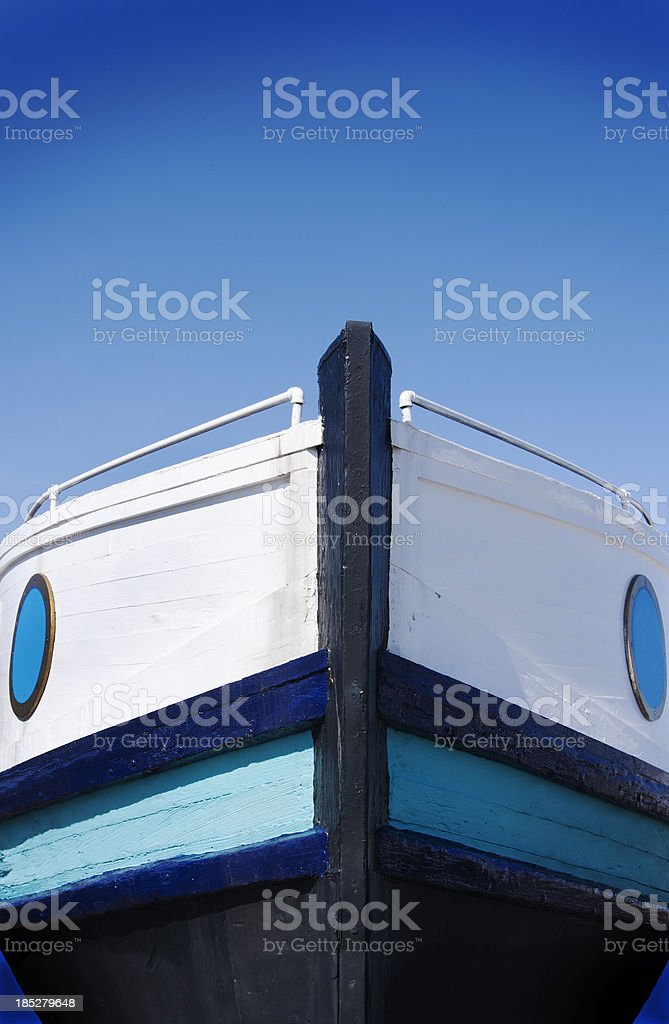 Front View, Wooden Fishing Boat Bow with Clear Blue Sky stock photo