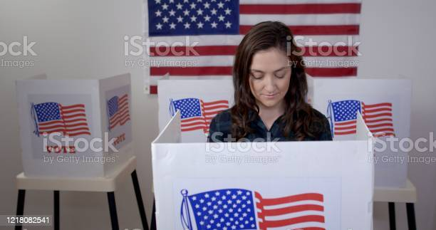 Front view young woman in booth at polling station picture id1218082541?b=1&k=6&m=1218082541&s=612x612&h=yi5zcqin8152a icijkardo0ejcyvf0nz9z mp2kmjs=