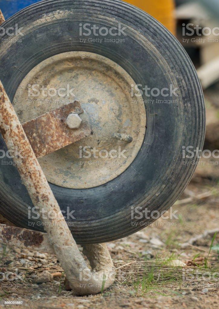 Front wheel of a wheelbarrow stock photo