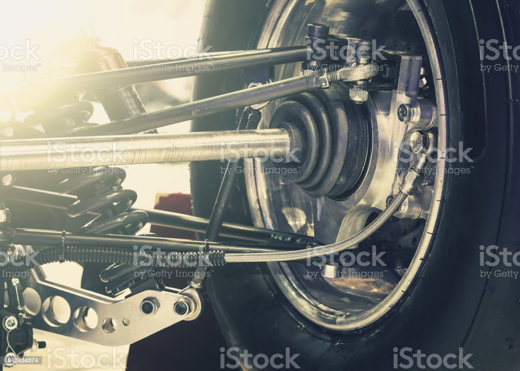 Front wheel of drive car with new tire and Shock Absorber stock photo