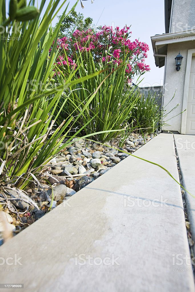Front Yard Landscaping With Pebbles royalty-free stock photo