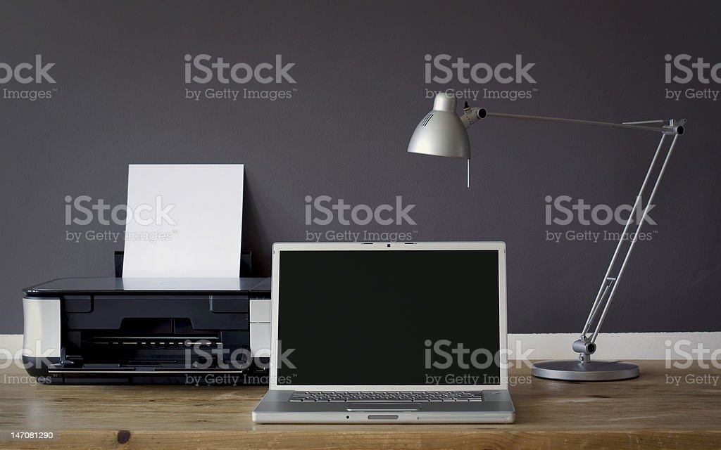 frontal Home office desk frontal Home office desk with laptop and printer Computer Printer Stock Photo