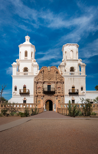 istock Frontal shot of Mission of San Xavier del Bac in Tucson with church tower and historic entrance 1198718811