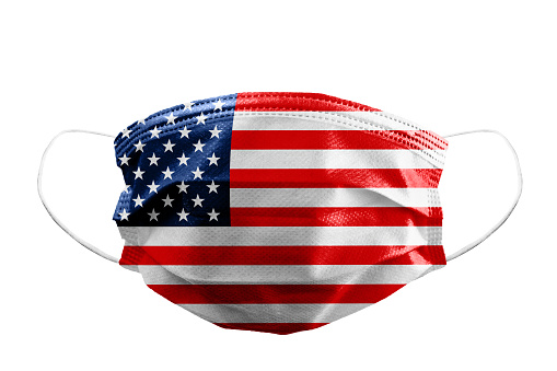 Frontal view of surgical mask USA or American flag isolated with rubber ear straps to cover the mouth and nose to protect face from virus