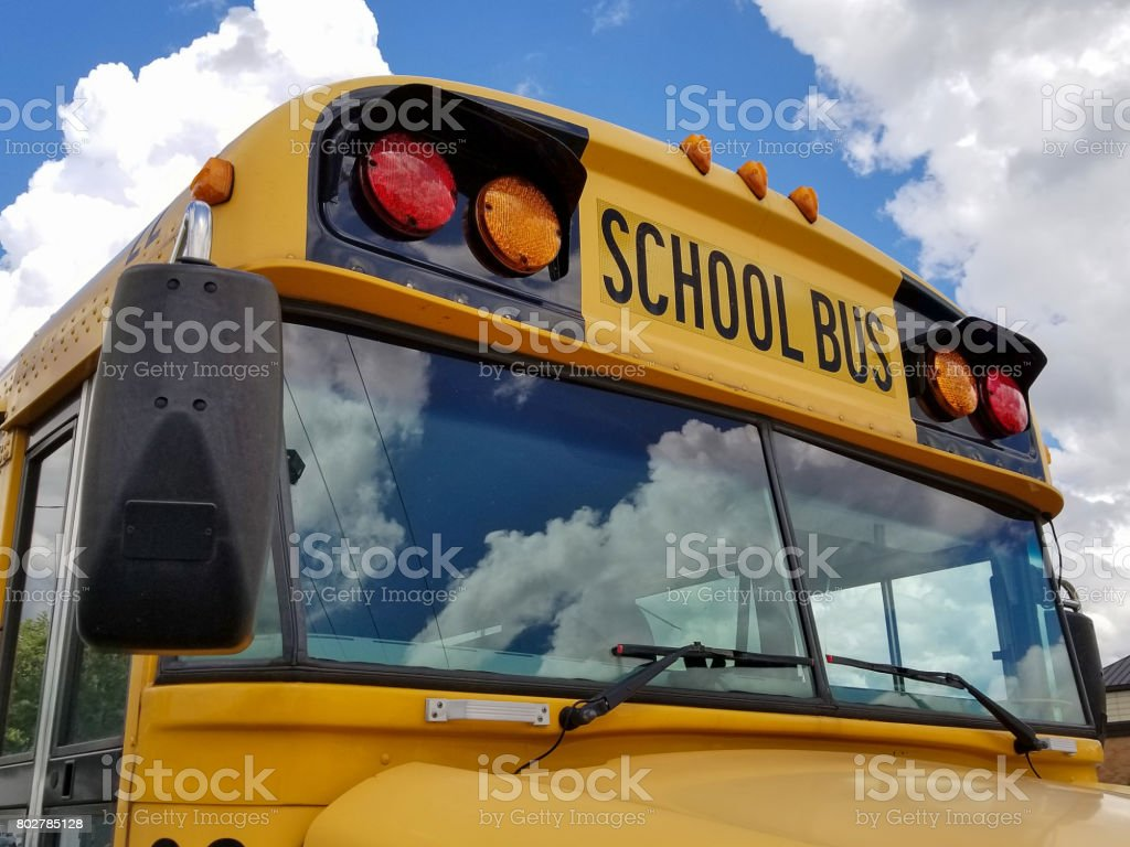 frontal view of yellow school bus stock photo