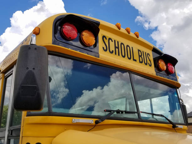 frontal view of yellow school bus - school bus stock photos and pictures