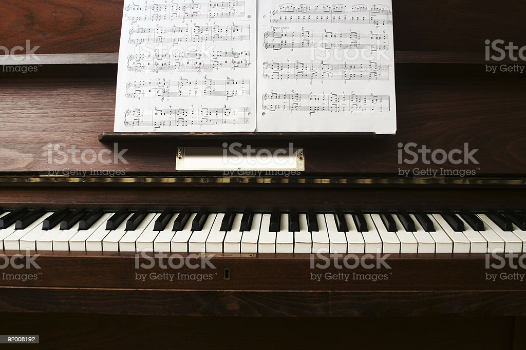 Frontal View on a simple Piano with some Notes royalty-free stock photo