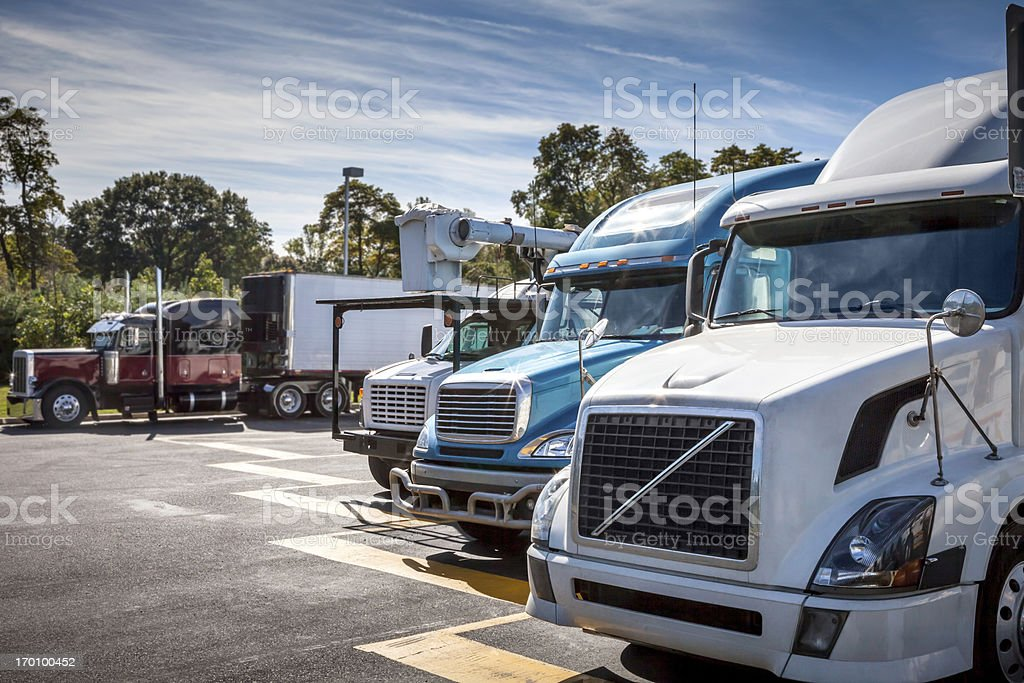 Fronts of Trucks in Parking Lot on a Sunny Afternoon stock photo