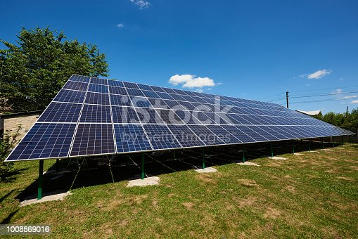 istock Frontview of big solar panels installed on outdoors opened space. 1008869016