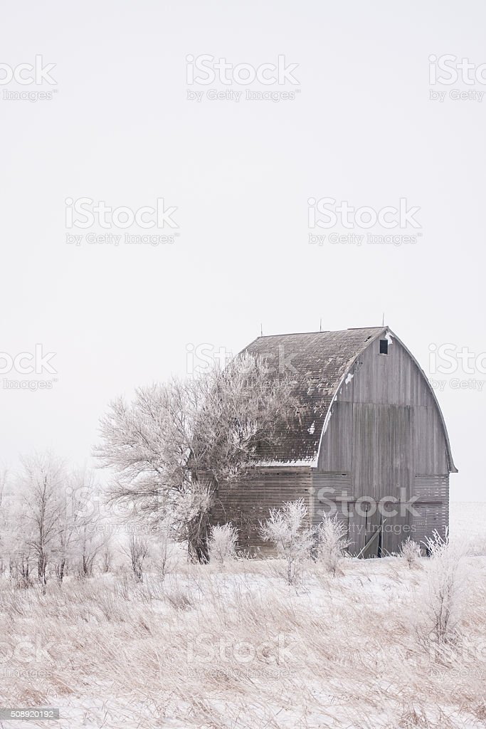 Frost and Snow Accent Old Iowa Farm Building stock photo
