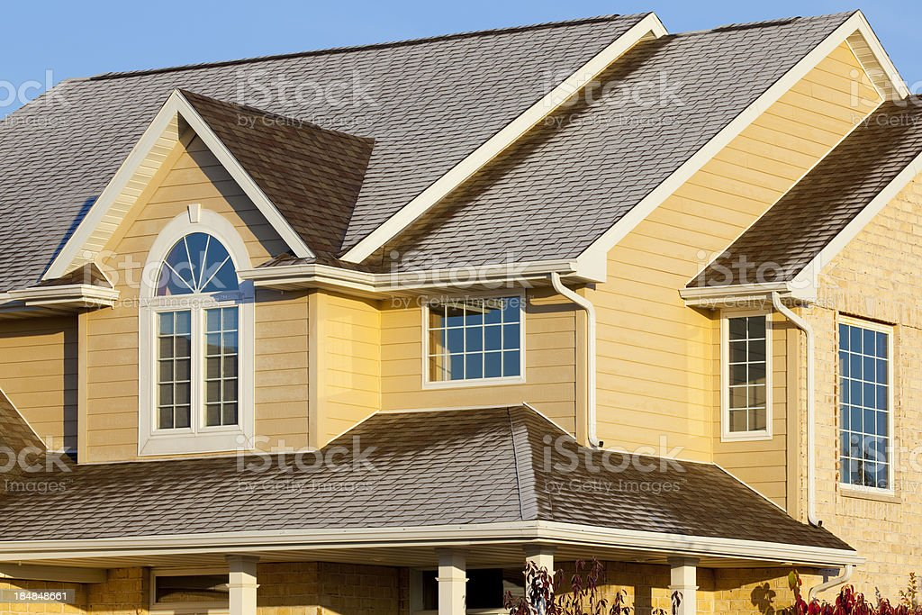Frost Covered House With Brick, Vinyl Siding stock photo