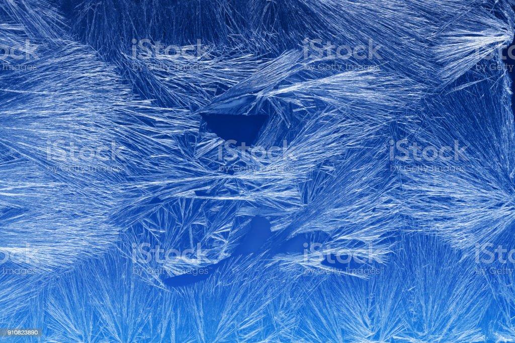 Frost pattern on a window glass stock photo