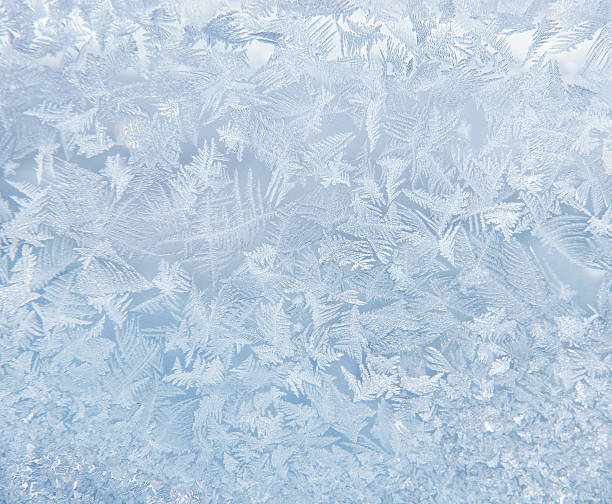 frost pattern on the window - ice crystal stock pictures, royalty-free photos & images