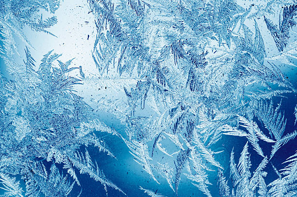 frost pattern on window - ice crystal stock pictures, royalty-free photos & images