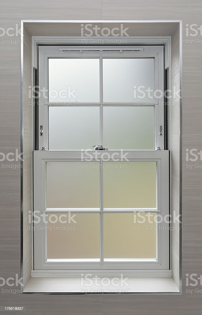 frosted bathroom window stock photo | istock