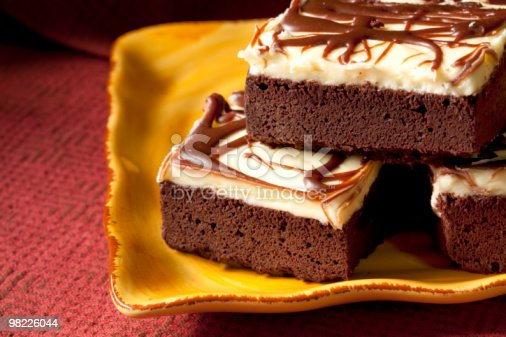 Frosted Brownies On Yellow Plate Stock Photo & More Pictures of Baked