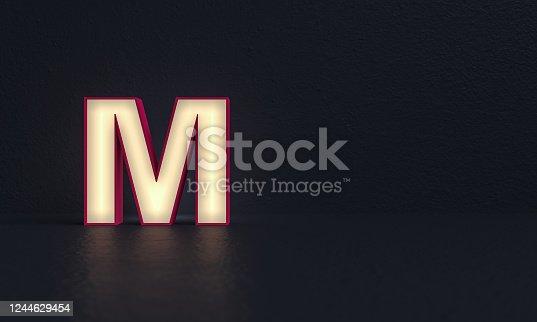 istock Frosted glass alphabet letter M - dark background - 3d rendering 1244629454