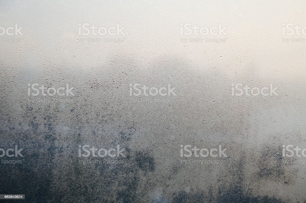 Frosted on glasses or mirror fogged up Frosted on glasses or mirror fogged up in morining time while raining Abstract Stock Photo