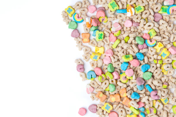 frosted toasted oat cereal with fun shaped marshmallows on white background. - muesli imagens e fotografias de stock
