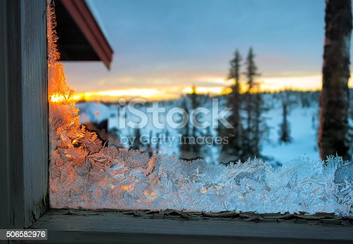 Frost-work on an run down window of a mountain cabin in Norway
