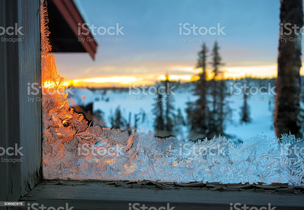 Frost-work on an run down window in Norway stock photo