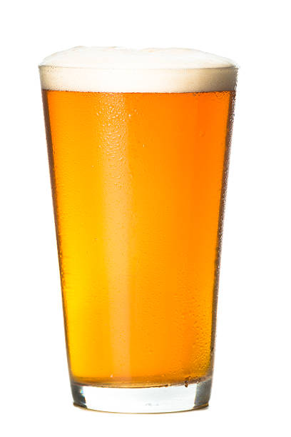 Frosty Craft Beer on White Frosty pint glass of craft beer microbrew beer isolated on white background pilsner stock pictures, royalty-free photos & images