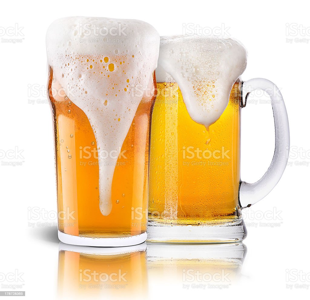 Frosty fresh beer collection with foam isolated stock photo