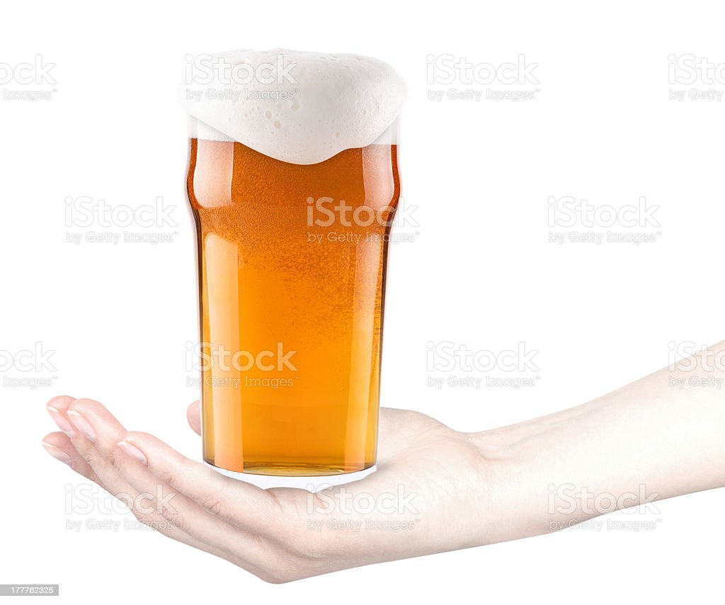 frosty fresh glass of beer with woman hand stock photo