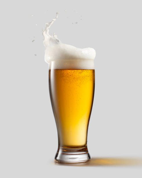 Frosty glass of light beer with foam stock photo
