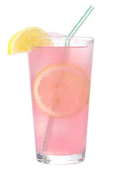 frosty glass of pink lemonade with straw isolated - 檸檬水 個照片及圖片檔