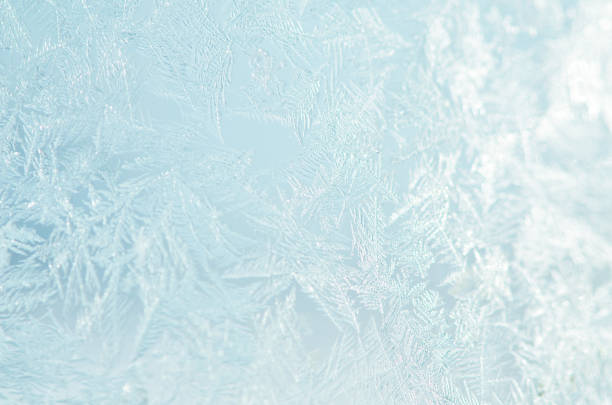 frosty natural pattern on winter window. - snowflake background stock pictures, royalty-free photos & images