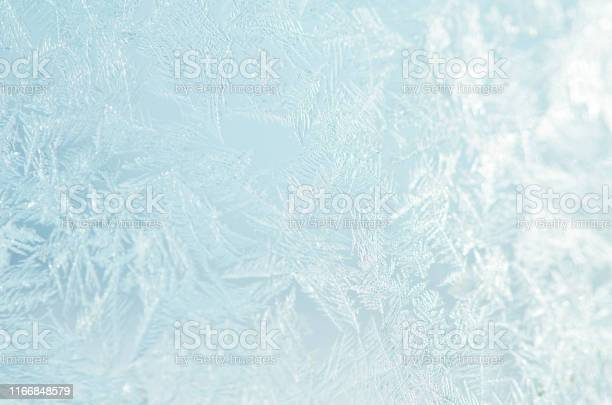 Photo of Frosty natural pattern on winter window.