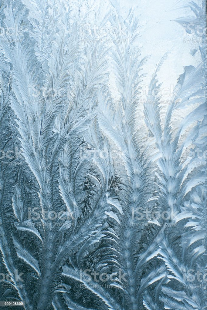 Frosty patterns on glass in winter stock photo