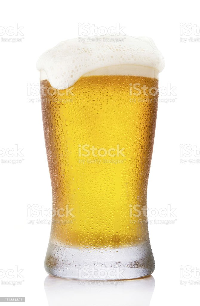 Frosty pint glass of beer stock photo