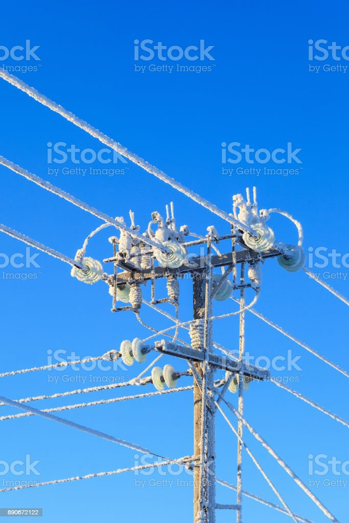 Frosty power pole stock photo
