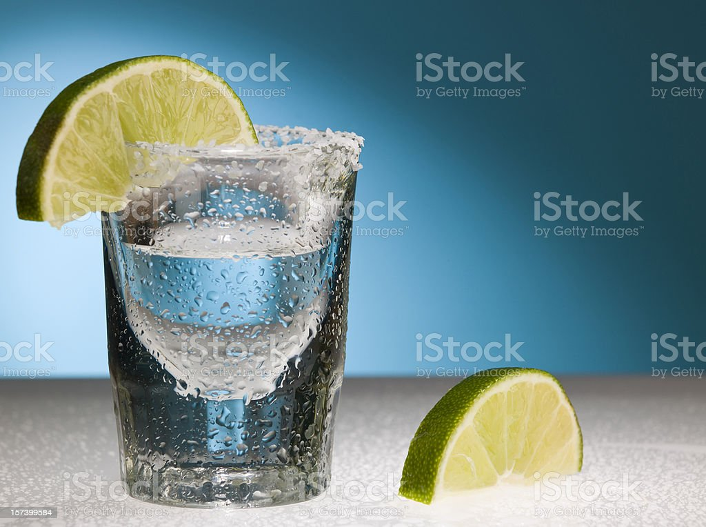 Frosty shot glass with limes royalty-free stock photo
