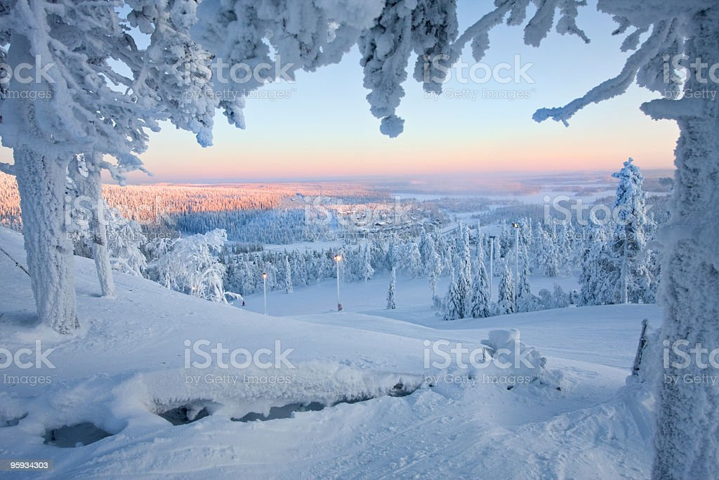 Frosty sunset at the frozen forest of Santa Claus stock photo