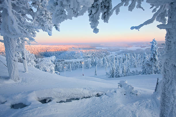 frosty sunset at the frozen forest of santa claus - finland stock pictures, royalty-free photos & images