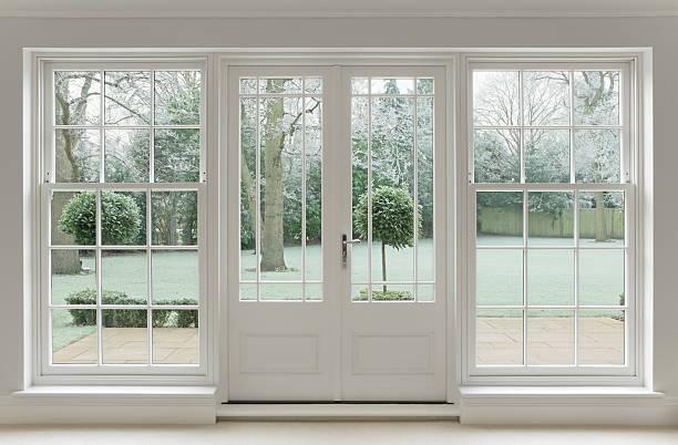 frosty view through white windows stock photo