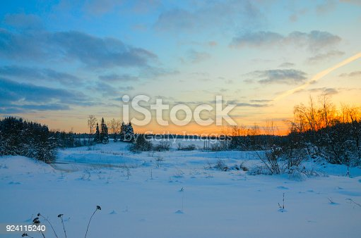 1034754000istockphoto Frosty winter landscape.Twilight.Cold morning.Snow covered trees.Sunrise. 924115240