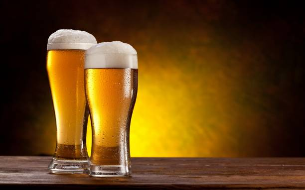 Froth beer on two glass - drink Forth beer on two glass - dark background - drink beer glass stock pictures, royalty-free photos & images