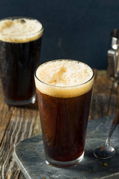 Frothy Nitro Cold Brew Coffee Frothy Nitro Cold Brew Coffee Ready to Drink nitrogen stock pictures, royalty-free photos & images