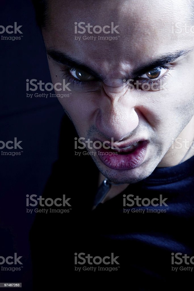 Frown of scary sinister evil vampire man royalty-free stock photo
