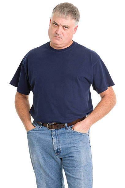 Frowning Angry Man Portrait of a mature man on a white background. http://s3.amazonaws.com/drbimages/m/jk.jpg hands in pockets stock pictures, royalty-free photos & images