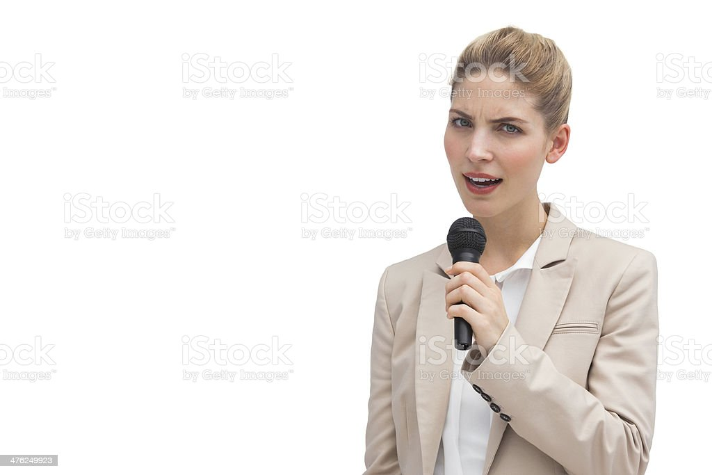 Frowning businesswoman with microphone royalty-free stock photo