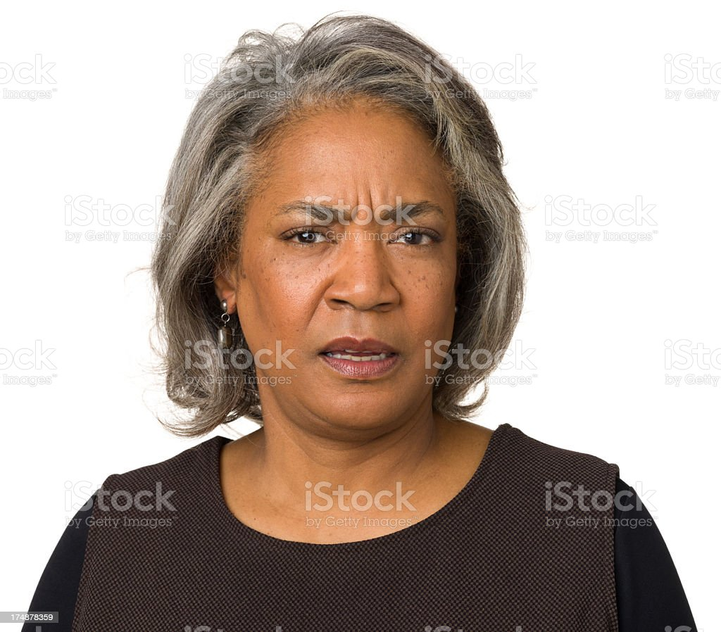 Frowning Nervous Mature Woman stock photo