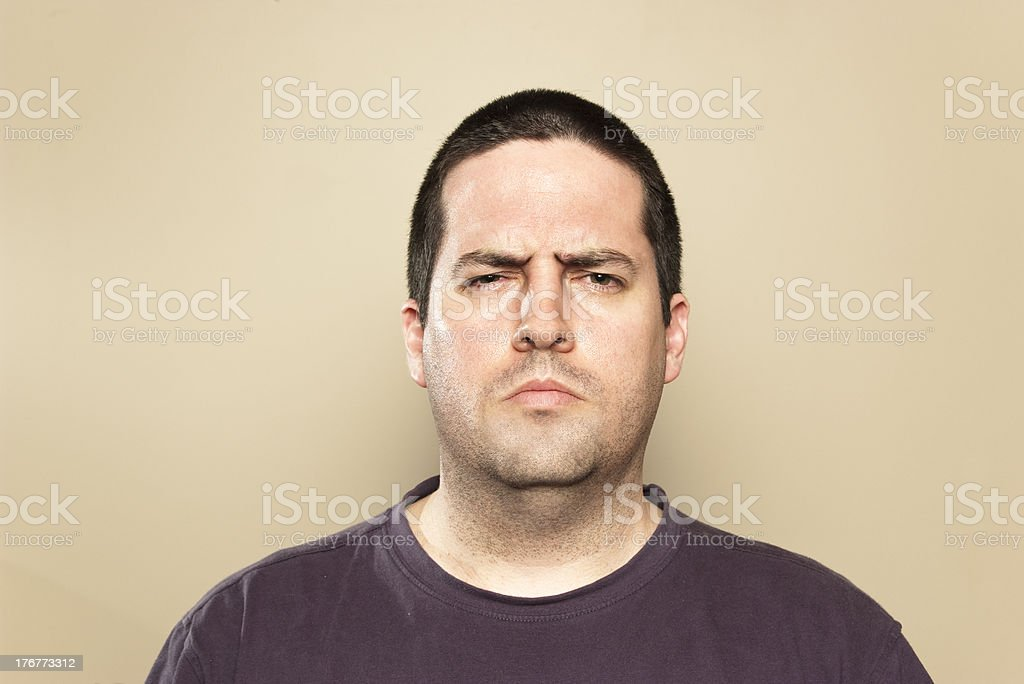 Frowning or squinting man royalty-free stock photo