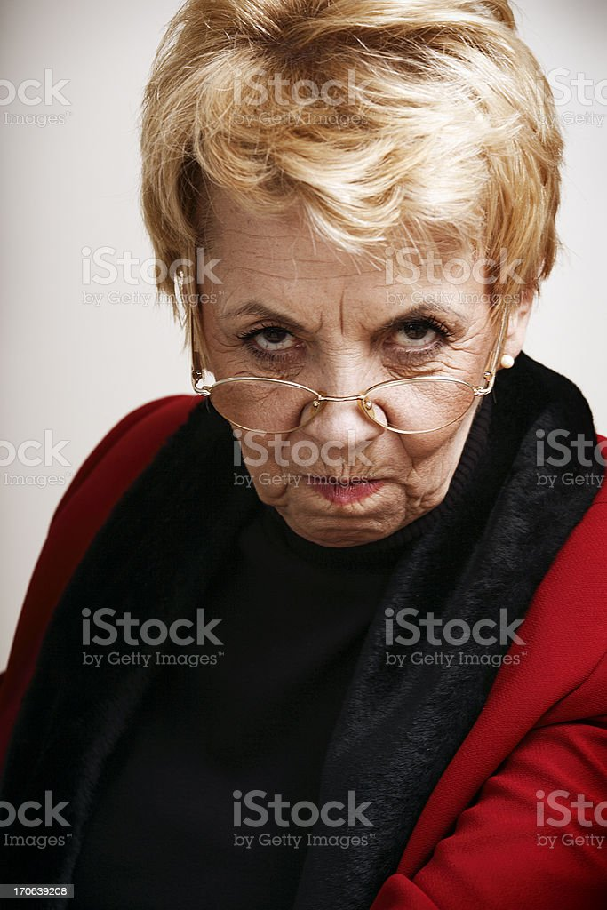 Frowning senior woman stock photo
