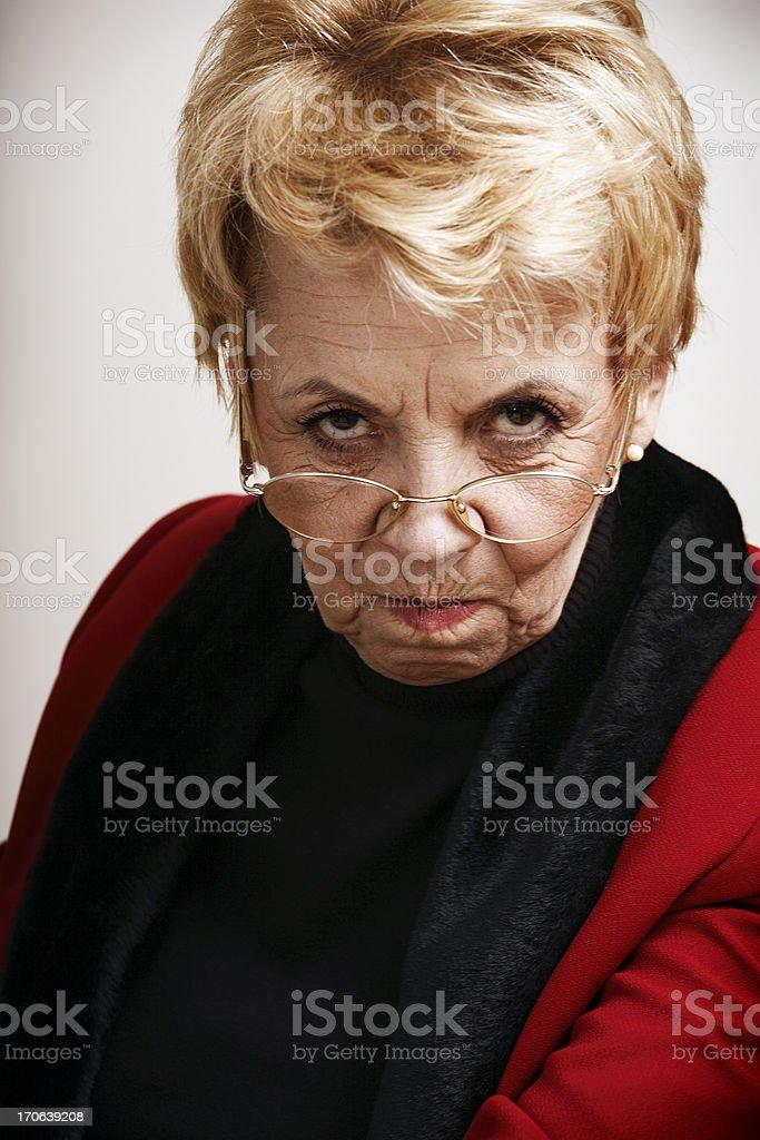 Frowning senior woman stock photo