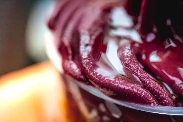 Frozen açaí with honey in a glass. This version of açaí is a more natural alteration of traditional açaí from the Amazon. Frozen açaí is often mixed with guaraná and banana syrup. Frozen açaí with honey in a glass. This version of açaí is a more natural alteration of traditional açaí from the Amazon. Frozen açaí is often mixed with guaraná and banana syrup. gelado stock pictures, royalty-free photos & images